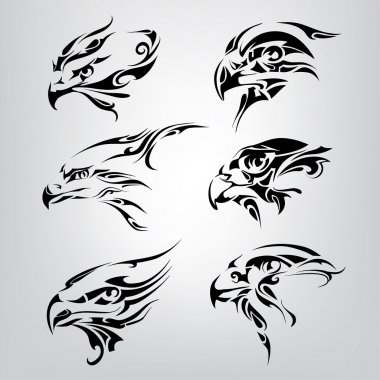 Silhouette of  heads of birds.
