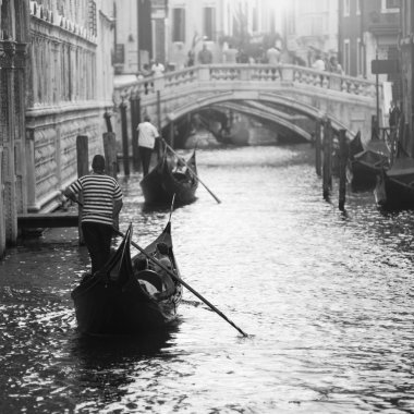 two gondolas with gondoliers in Venice, Italy