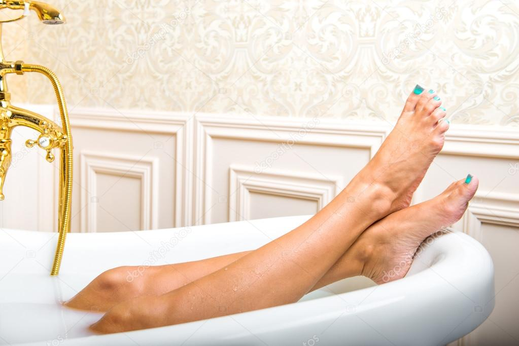 Beautiful Woman Legs Lying In White Bathtub U2014 Photo By Mr.bodich