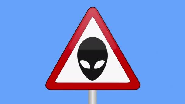Symbol UFO nebo varovný znak.