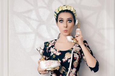 Surprised Retro Woman With Vintage Phone