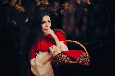 Scared Little Red Riding Hood Hiding in the Forest