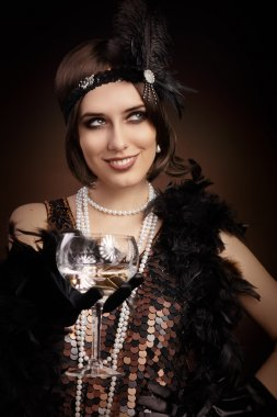 Retro 20s style woman holding champagne glass