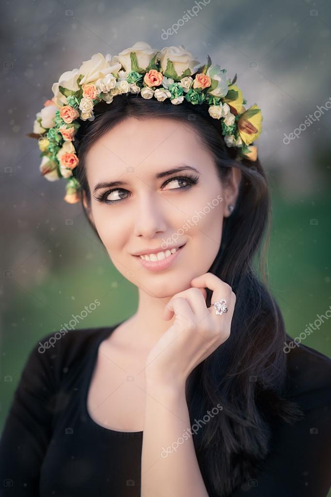 Portrait of a Happy Girl with Floral Wreath Outside