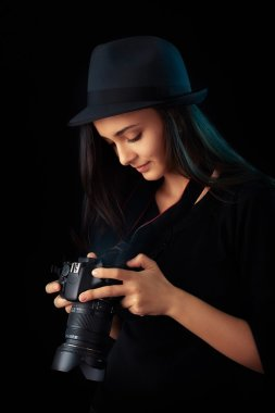Young photographer girl with digital camera