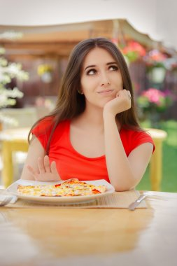 Young Woman Refusing To Eat a Pizza