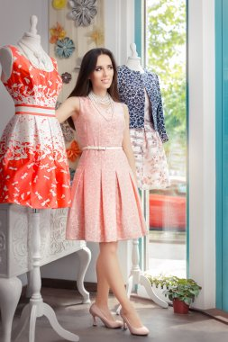 Woman in Pink Dress in Fashion Store