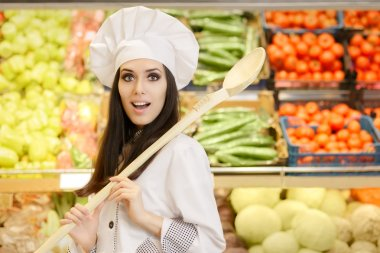 Funny Lady Chef with Big Spoon Shopping for Vegetables
