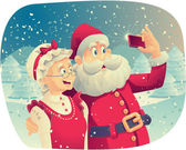 Fotografie Santa Claus and Mrs. Claus Taking a Photo Together