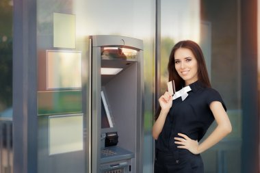 Woman with Credit Card at ATM cash machine