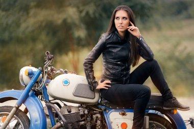 Biker Girl in Leather Jacket on Retro Motorcycle