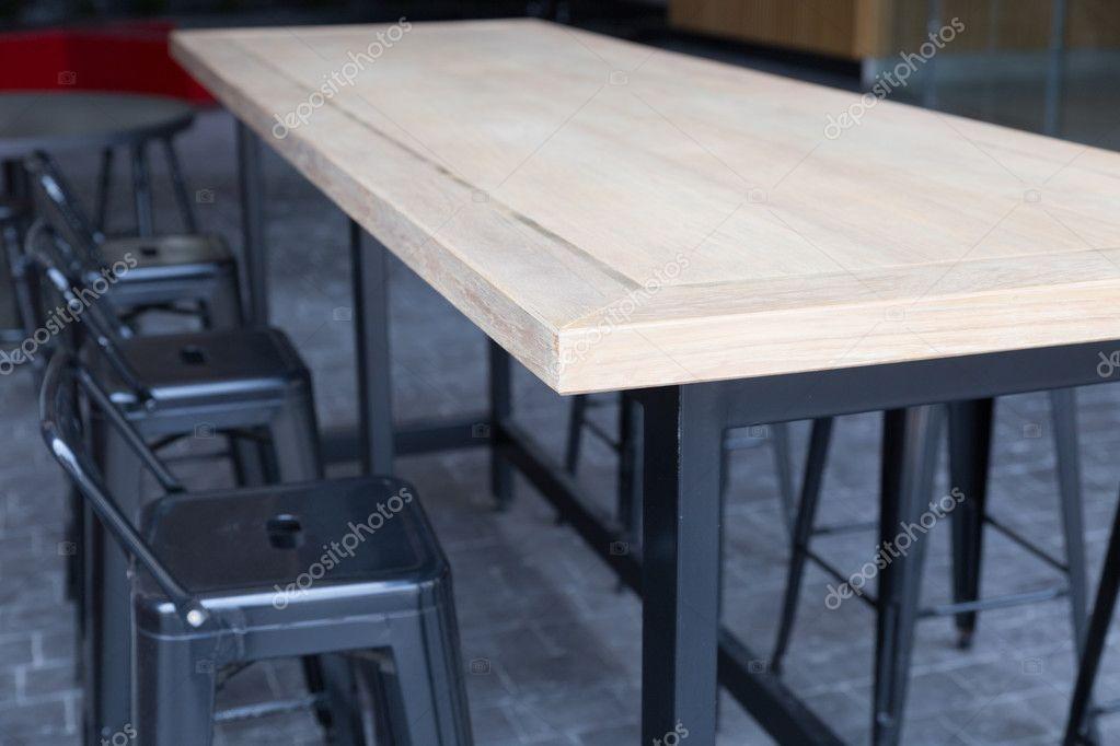 Tavolo in legno marrone con sgabello u2014 foto stock © psisaa #104857136