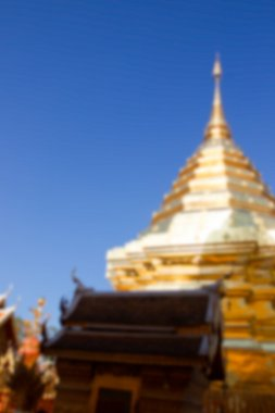 blurry defocused image of asian golden pagoda with the pavilion