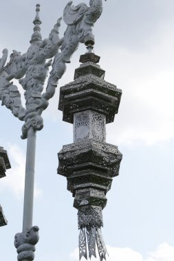 silver sculpture lamp on the pole