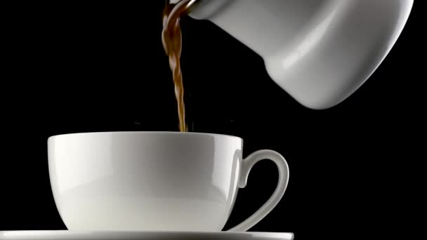 Hot drink with steam. Hot coffee or tea is poured into a white cup on an isolated black background. Close-up. Full HD video 1920x1080