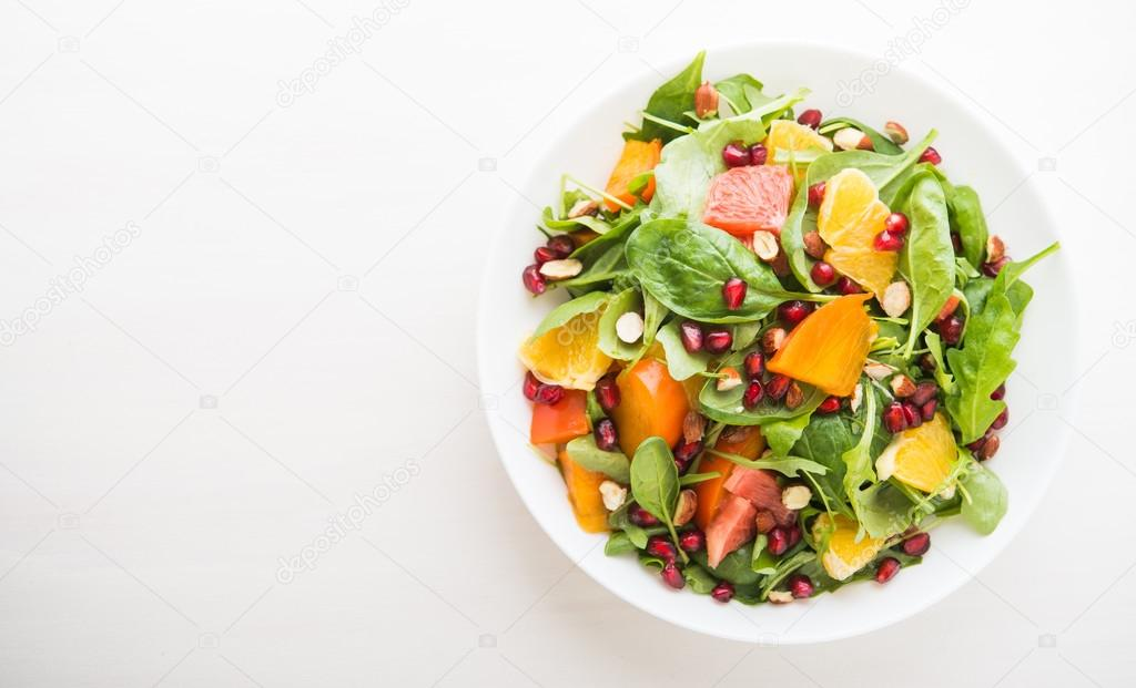Fresh Salad With Fruits And Greens On White Wooden