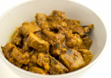 Tasty Indian lamb curry against white