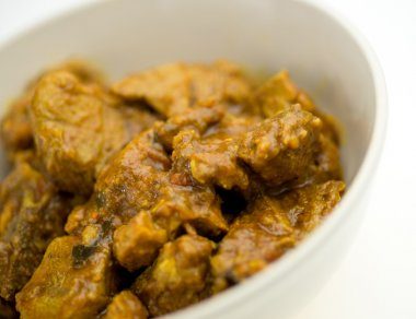 Spicy Indian goat lamb curry in bowl