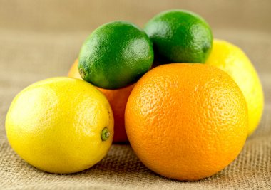 Pile of juicy citrus fruits with limes, lemons and oranges