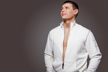 Portrait of Masculine Strong Tanned Caucasian Man in White Jacke