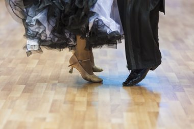 Closeup of Legs of the Professional Dance Couple Performing Euro