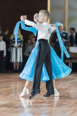 Minsk, Belarus-September 26, 2015: Zakharchenko Oleksiy and Vasina Anna  Perform Juvenile-1 Standard Program