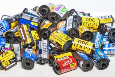 Minsk, Belarus-May 30, 2015: Bulk Variety of Old Photo Films Cassettes of Different World Leading Manufacturers Placed in Heap Together against White Background