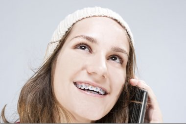 Dental Cure, Orthodontics Concept and Ideas. Blond Caucasian Teenager Wearing Teeth Braces