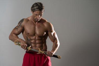 Warrior With Short Sword Over Grey Background