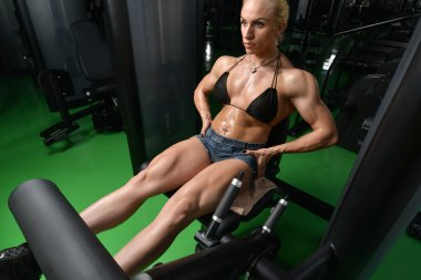 Young Woman Doing Heavy Weight Exercise For Legs