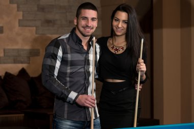 Smiling Happy Couple Playing Billiard