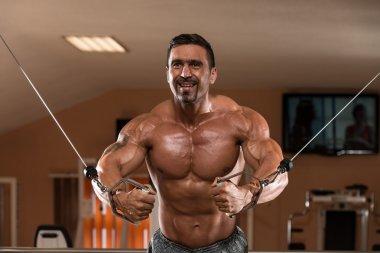 Bodybuilder Doing Exercise For Chest