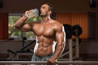 Bodybuilder Drinking Water From Shaker