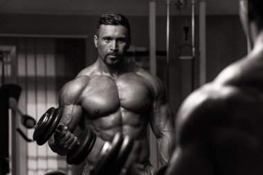 Bodybuilder Exercising Biceps