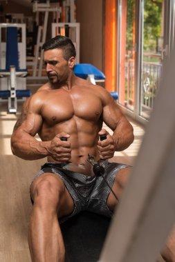 Bodybuilder Doing Heavy Weight Exercise For Back