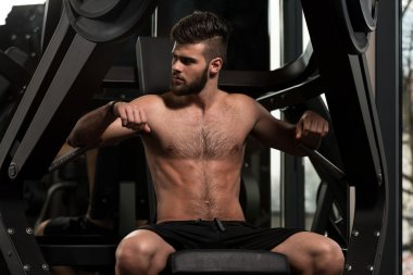 Handsome Man Doing Heavy Weight Exercise For Chest