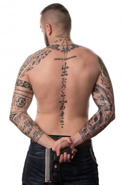 Rear View Of Back Tattooed Man With Gun