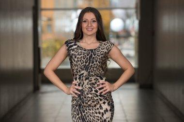 Beautiful Woman Wearing A Dress With Animal Print