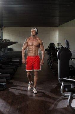 Aesthetic Man Listening Music In Modern Fitness Center
