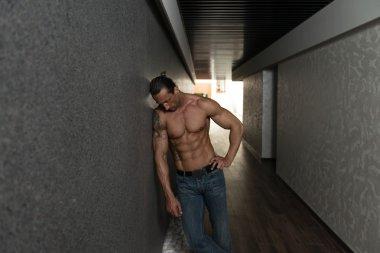 Handsome Man Poses In Modern Corridor