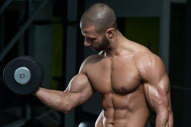 Bodybuilder Exercise With Dumbbells