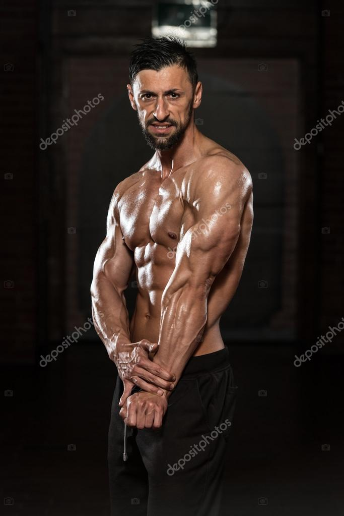 Healthy Man Flexing Muscles