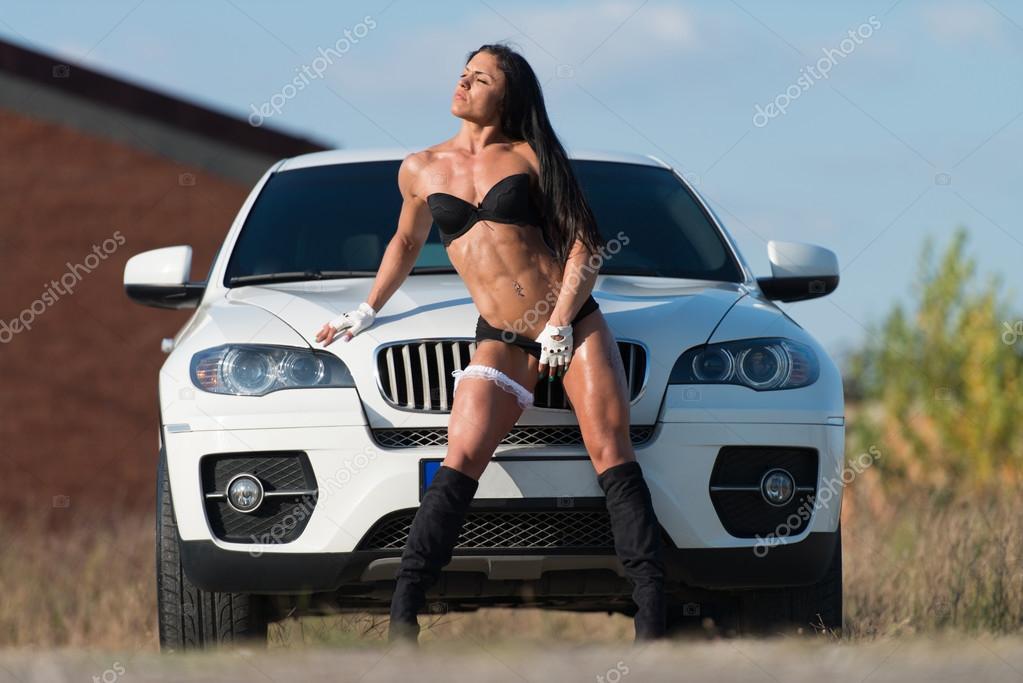 jonge sexy vrouw voor een auto stockfoto ibrak 87622258. Black Bedroom Furniture Sets. Home Design Ideas