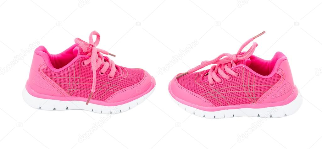 75a99bb3beb32 Pair of pink training shoes for girls. Isolated on a white background. —  Photo by indigolotos