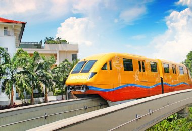 May 3, 2014 Sentosa island, Singapore. monorail train in bright yellow color.