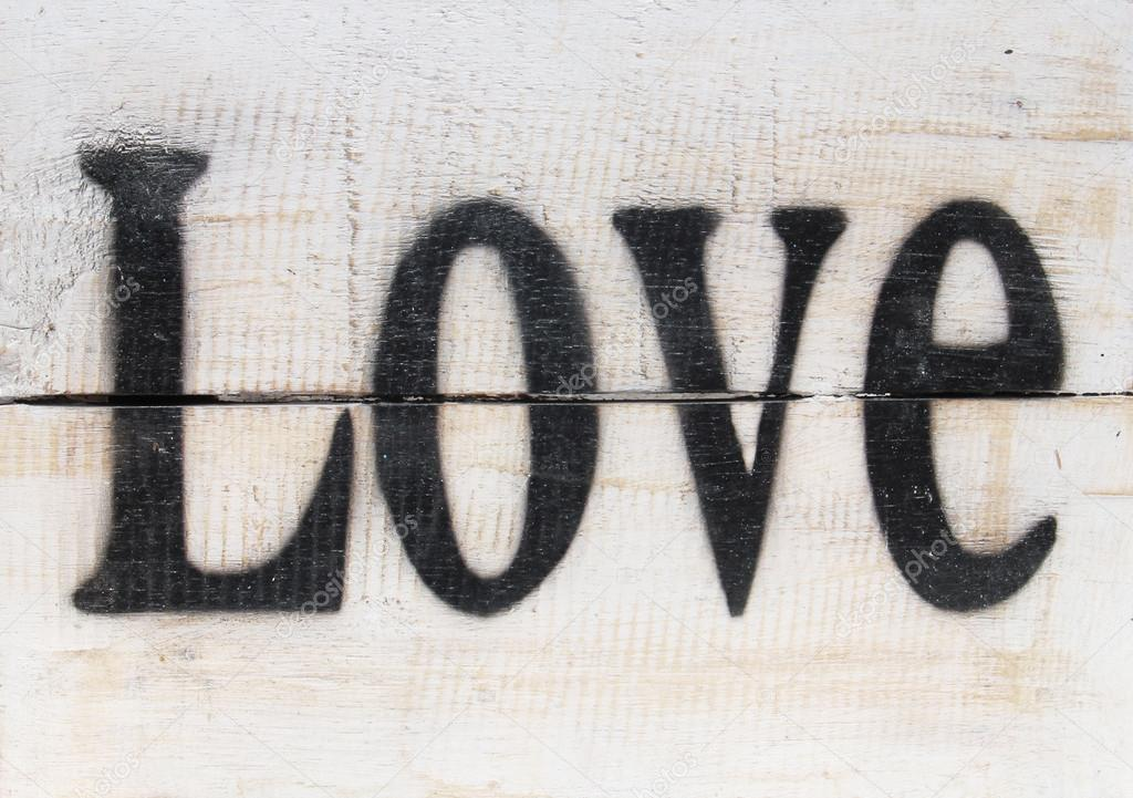 The word love on a wooden vintage background