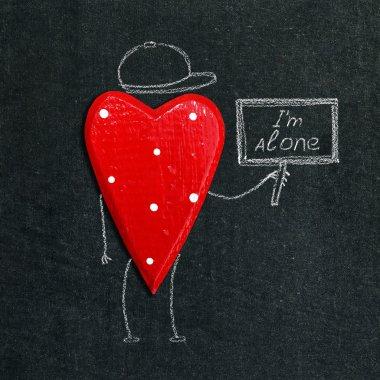 Alone heart on the chalkboard