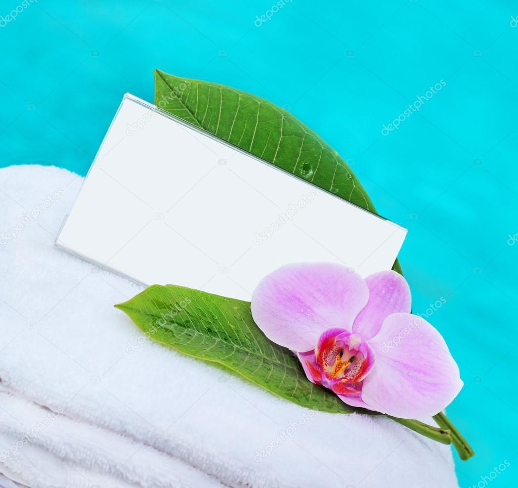 Card and flower on a white towel