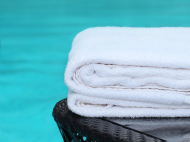 Clean white towel poolside