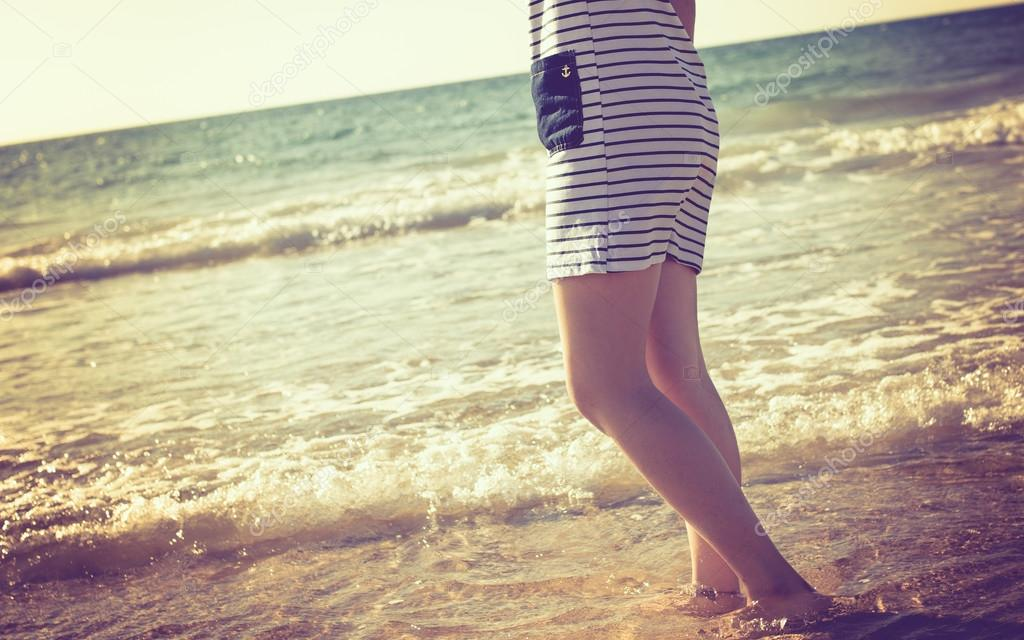 girl standing in water on beach